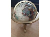 Gemstone globe with compass on a brass stand