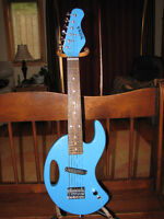 two electric guitars kids or travel / novelty guitars 6 string