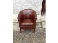 Brown leatherette tub chair