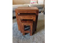 Nest of three solid oak tables