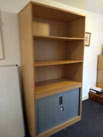 Tall office cupboard with local able base with sliding doors