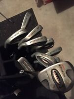 Northwestern golf clubs irons and a 5 wood