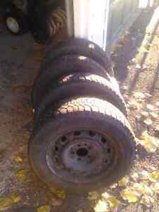 NEWER PRICE! Winter tires with rims off 2003 dodge caravan
