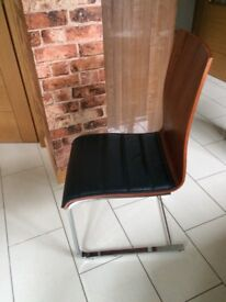 Still for sale at Reduced price - Set of four contemporary dining chairs.
