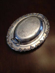 Silver covered vegetable dish.