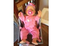 Baby Born doll with bike/travel seat and outfits