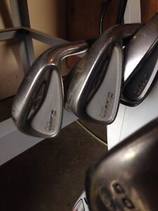 2 titleist drivers and king cobra irons