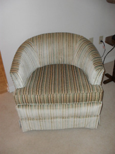 Two Low Back Arm Chairs