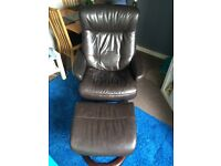 Brown leather swivel chair and matching footstool
