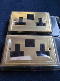 Brand New 2 x Brass 2 Gang Switched Sockets