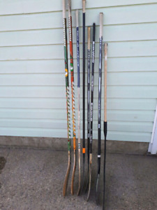 Lot of hockey sticks