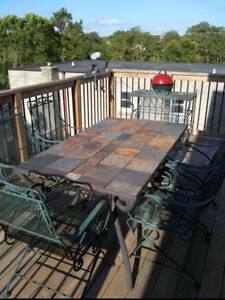 Gorgeous Slate Patio set with Wrought Iron Chairs. Rarely used.