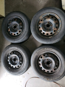 4x Honda rims and summer tires with original hubaps