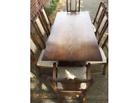 Solid wood dining table and 8 chairs * free delivery