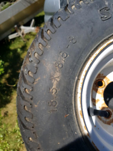 TRAILER TIRES 18.5 INCHES AND A TRAILER JACK