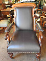 unique antique reclining arm chair, new leather upholstery