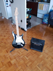 Behringer guitar with stand and amp