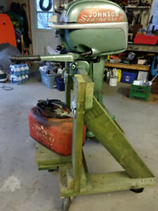 Antique working boat motor, with stand and fuel tank.
