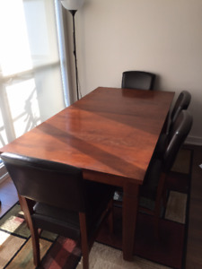 Dining room table with six chairs and one bench