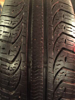 215/60/R15 Pirelli P4 Four season tires 5x115 factory Chevy rims