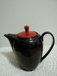 black teapot with a red lid