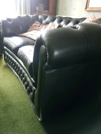 Leather olive green Chestefield style sofa set. 3 and 2 seater.