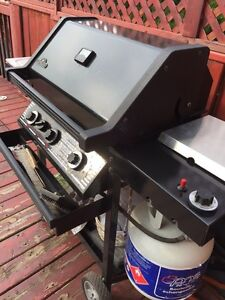 Napoleon BBQ machine with ceramic coal and propane