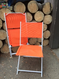 2 Collapsable Orange Chairs