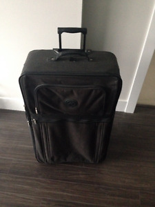 Dark green Suitcase - $20 (Langley)
