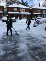 Two young adults looking for work shoveling snow and raking