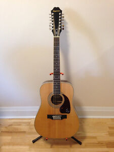 New 12 String Guitar with tuner, stand and picks.