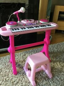 Pink toy keyboard musical toy complete with stool