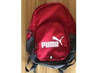 Red and grey PUMA backpack bag