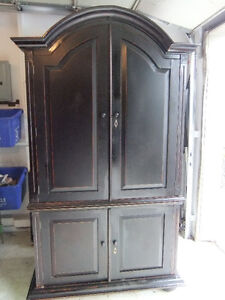 solid wood tall wardrobe with lots of storage