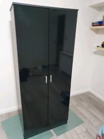 Black wardrobe with black gloss doors