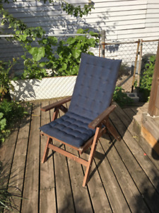 Wooden deck chair with cushion