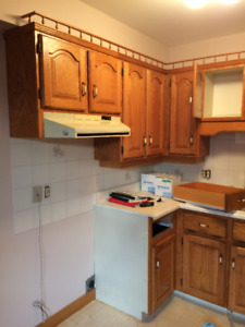 Kitchen cabinets, 2 vanities, and stainless steel sinks