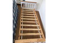 Single wooden frame bed