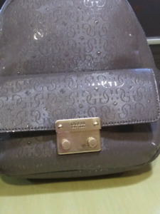 Brand new guess wallet/backpack