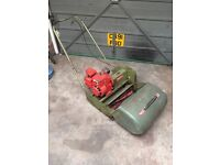 Self propelled cylinder mower