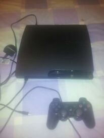 PS3 slim with games and leads