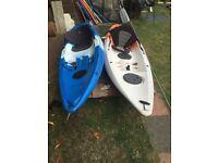 2 kayaks with seating