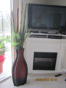 Tall Red and Black vase with reeds and bamboo and flowers