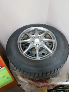 4 Champiro winter tires 225/70R16 on rims with hubcabs