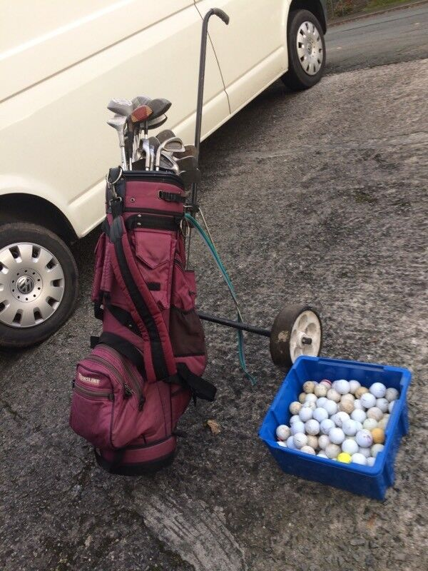 Golf caddy with golf balls
