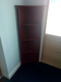 Dark wood corner cabinet