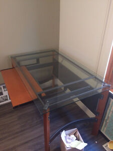 Slightly used glass top desk. IDEAL FOR STUDENTS