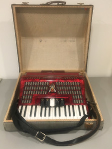 A beautiful, red piano accordion for hobbyists
