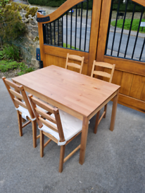 IKEA dining table with 4 chairs with seat pads
