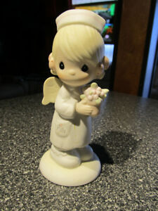 """ Angel Of Mercy""  Precious Moments figurine."